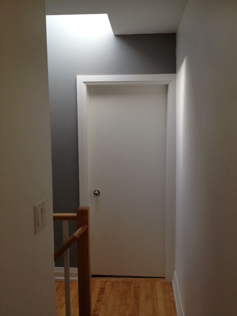 The view of the accent wall when looking down the wallway