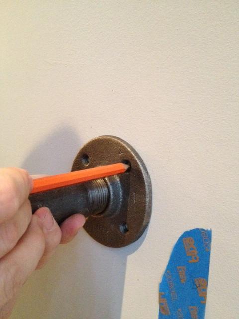 Marking the shelf bracket holes