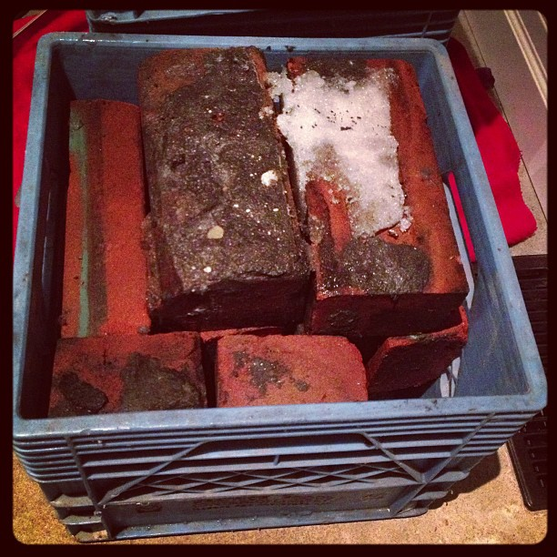 One milk crate holds 12 bricks. Each brick weighs 5lbs. So this crate-o-bricks is weighing in at 60lbs.