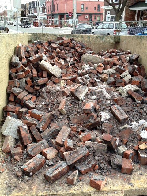Dumpster full of Bricks