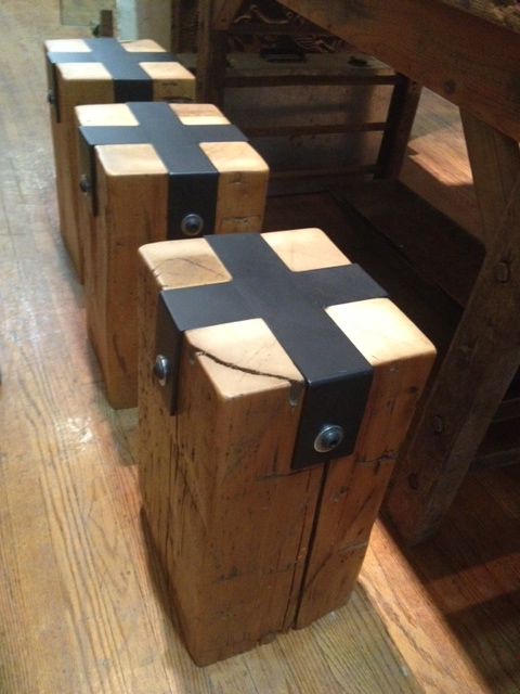 Made from reclaimed materials, these modern looking industrial stools would be great at a dining table or as end tables