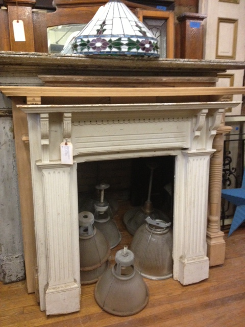 Lovinf this simple but classic mantle. Made we want to bring it home even though the storefront doesnt have a fireplace! Would be cute with stacked logs in the hearth