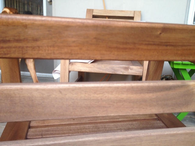 The slat on the top has been oiled,  whereas the slat at the bottom has not.