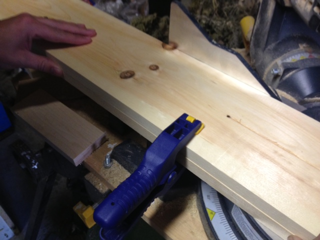 Cutting frame pieces to size. Cut both sides at the same time to make sure they're exactly the same size