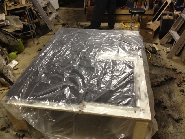 Covering forms with plastic to keep in moisture
