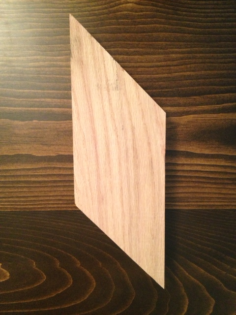 Two pieces of wood cut into parallelograms