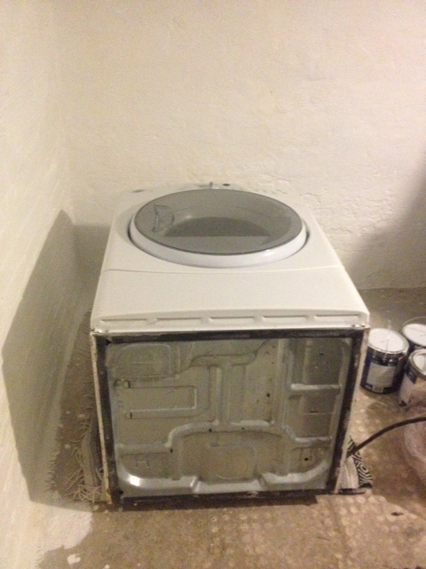 The dryer laid on its back ready for its pedestal