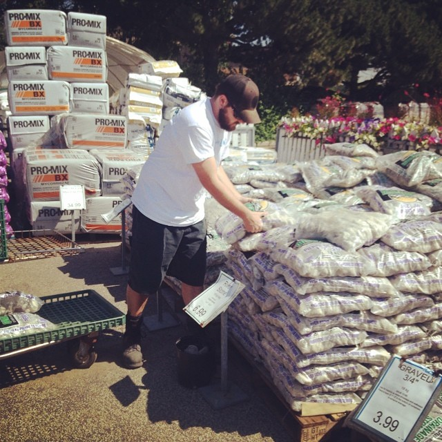 Trip to the garden center for 13 bags of large river rock. All told we have 25 bags of rock under and beside the path. Wowza.