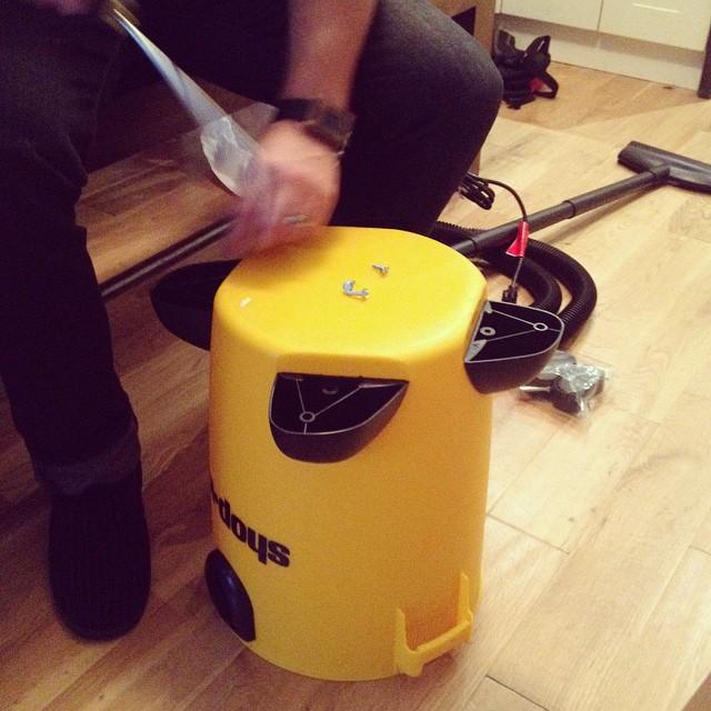 Assembling new yellow shop vac vacuum
